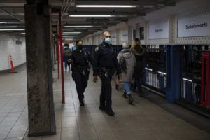NEW YORK TIMES                                 Police officers patrol the Union Square subway station in Manhattan last Friday.