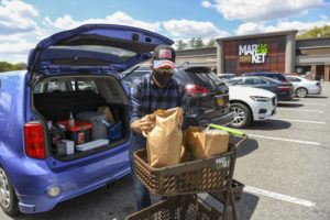 NEW YORK TIMES                                 Joe Glickman loads groceries into his car in Slingerlands, N.Y., outside Albany, on Thursday.