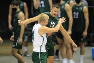 Jamm Aquino/jaquino@staradvertiser.com                                 Hawaii opposite Rado Parapunov (19), right, and libero Gage Worsley (6) chest bumped while taking to the court on Saturday, April 17, at Stan Sheriff Center. Both were named first-team All-Americans today, along with middle blocker Patrick Gasman.
