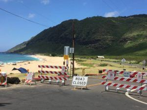 SUSAN ESSOYAN / SESSOYAN@STARADVERTISER.COM                                 On April 21, the road and access to public parking at the state's Keawaula Beach Park remained closed, as it has been for more than a year.