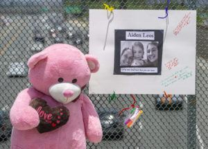 ASSOCIATED PRESS / MAY 22                                 A large stuffed toy bear and a poster board with a photo and notes are part of a memorial on the E. Walnut Avenue overpass of the 55 freeway in Orange, Calif., for Aiden Leos, a 6-year-old boy who was shot and killed during a road-rage attack.