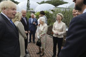 POOL VIA AP                                 Britain's Queen Elizabeth II speaks to US President Joe Biden and his wife Jill Biden during reception with the G7 leaders at the Eden Project in Cornwall, England.