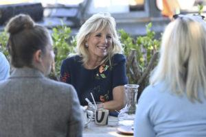 DANIEL LEAL-OLIVAS/POOL VIA AP                                 U.S. First Lady Jill Biden smiles as she meets military surfers and their families in Newlyn, Cornwall, England, on the sidelines of the G7 summit, Saturday June 12. Biden met with veterans, first responders and family members of Bude Surf Veterans, a Cornwall-based volunteer organization that provides social support and surfing excursions for veterans, first responders and their families.