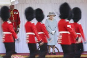 CHRIS JACKSON/POOL VIA AP                                 Britain's Queen Elizabeth II watches a ceremony to mark her official birthday at Windsor Castle, Windsor, England, Saturday, June 12. In line with government advice The Queen's Birthday Parade, also known as Trooping the Colour, will not go ahead in its traditional form.