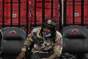 ASSOCIATED PRESS / APRIL 18                                 Rapper Polo G watches during the second half of an NBA basketball game between the Miami Heat and the Brooklyn Nets in Miami. Officials say rapper Polo G has been arrested in Miami on charges including battery on a police officer, resisting arrest with violence and criminal mischief. Jail records show 22-year-old Taurus Bartlett was booked into jail on Saturday, June 12.