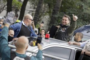 ASSOCIATED PRESS                                 Brazil's President Jair Bolsonaro flashes a thumbs up as he arrives to take part in a caravan of motorcycle enthusiasts in a show of support for Bolsonaro, in Sao Paulo, Brazil, Saturday, June 12.