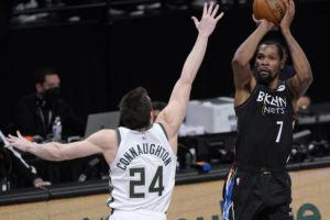 ASSOCIATED PRESS                                 Brooklyn Nets forward Kevin Durant shoots as Milwaukee Bucks guard Pat Connaughton defends during the fourth quarter of Game 5 of a second-round NBA basketball playoff series today in New York.