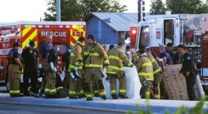 ADOLPHE PIERRE-LOUIS/THE ALBUQUERQUE JOURNAL VIA AP                                 Albuquerque Fire Rescue crews work on victims of the fatal balloon crash at Unser and Central SW in Albuquerque, N.M., on Saturday, June 26. Multiple people were killed in the crash.