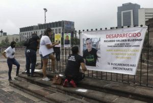 ASSOCIATED PRESS / JUNE 24                                 Family of Ricardo Valdes, who disappeared on the road on May 25, put up posters with their photography during a protest in Monterrey, Nuevo Leon state, Mexico. As many as 50 people in Mexico are missing after they set off on simple highway trips between the industrial hub of Monterrey and the border city of Nuevo Laredo; relatives say they simply disappeared on the heavily traveled road, which has been dubbed 'the highway of death,' never to be seen again.