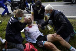ASSOCIATED PRESS                                 France's Cyril Lemoine gets medical assistance after crashing during the first stage of the Tour de France cycling race over 197.8 kilometers (122.9 miles) with start in Brest and finish in Landerneau, France.