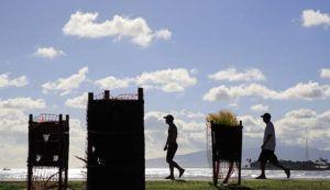 JAMM AQUINO / JAQUINO@STARADVERTISER.COM                                 Unmasked park users walk on Magic Island at Ala Moana Regional Park Wednesday. Hawaii Gov. David Ige lifted the masked mandate for outdoors last week.