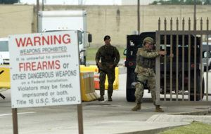 ASSOCIATED PRESS                                 Military police close a gate at JBSA-Lackland Air Force Base gate in San Antonio. The Air Force was put on lockdown as police and military officials say they searched for two people suspected of shooting into the base from outside.