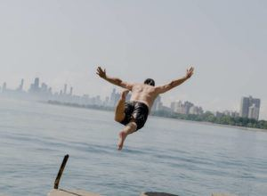 NEW YORK TIMES                                 Dan O'Conor hurtles into Lake Michigan in Chicago on Wednesday.