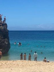 COURTESY HONOLULU EMS                                 Honolulu Ocean Safety today treated a man visiting from California who injured his back upon jumping from Waimea Bay rock. Officials say the rock is about 25 feet high, and that jumping from it is potentially very dangerous.