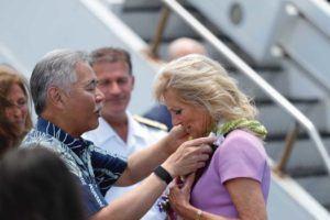 JAMM AQUINO / JAQUINO@STARADVERTISER.COM                                 Gov. David Ige greets First lady Jill Biden upon arrival today at Joint Base Pearl Harbor-Hickam.