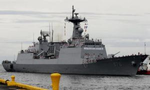 """ASSOCIATED PRESS                                 South Korean navy destroyer, the Munmu The Great, prepared to dock, in September 2019, at the Manila South Harbor for a three-day port call off Manila. South Korea's prime minister on Tuesday apologized for """"failing to carefully take care of the health"""" of hundreds of sailors who contracted the coronavirus on a navy ship taking part in an anti-piracy mission off East Africa."""