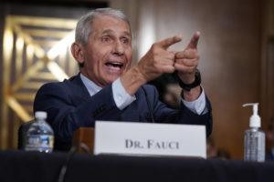 ASSOCIATED PRESS                                 Top infectious disease expert Dr. Anthony Fauci responds to accusations by Sen. Rand Paul, R-Ky., as he testifies before the Senate Health, Education, Labor, and Pensions Committee about the origin of COVID-19, on Capitol Hill in Washington, today.