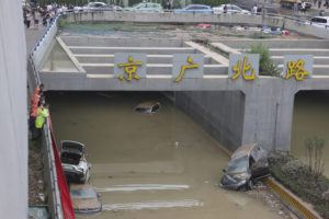 CHINATOPIX VIA AP                                 Rescuers watch as water is pumped from a road tunnel feared to be filled with vehicles caught in floodwaters in Zhengzhou in central China's Henan Province. The death toll from catastrophic flooding in the central Chinese city of Zhengzhou has continued to rise, state media reported Friday. The official China Daily newspaper and other media said the number included just Zhengzhou, the capital of Henan province. Other areas of the province have also faced heavy downpours, and rivers and reservoirs burst their banks.