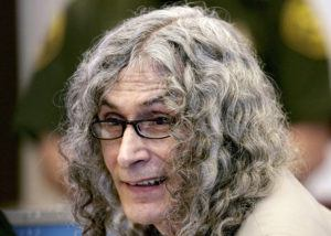 """ASSOCIATED PRESS / 2020                                 Rodney Alcala, a former death row inmate who was twice convicted of the 1979 killing of a 12-year-old Huntington Beach girl, sitting in Orange County Superior Court in Santa Ana, Calif. Alcala, a prolific serial torture-slayer dubbed """"The Dating Game Killer"""" has died while awaiting execution in California."""