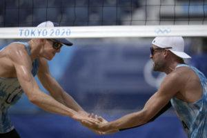 ASSOCIATED PRESS                                 Tri Bourne, left, of the United States, celebrates with teammate Jacob Gibb, after winning a men's beach volleyball match against Switzerland on Wednesday.