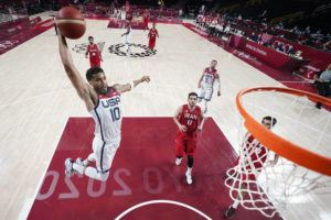 ASSOCIATED PRESS                                 United States' Jayson Tatum drives to the basket ahead of Iran's Navid Rezaeifar during a men's basketball preliminary round game at the 2020 Summer Olympics, Wednesday, in Saitama, Japan.