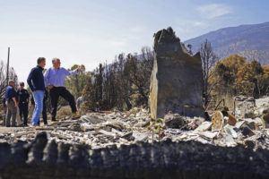 ASSOCIATED PRESS                                 California Gov. Gavin Newsom, front left, and Nevada Gov. Steve Sisolak tour homes destroyed by wildfires near where the Tamarack Fire ignited earlier in July in Gardnerville, Nev., today.