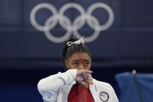 ASSOCIATED PRESS                                 Simone Biles, of the United States, watches gymnasts perform at the 2020 Summer Olympics, Tuesday, in Tokyo.