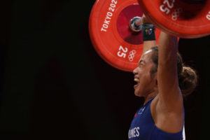 ASSOCIATED PRESS                                 Hidilyn Diaz of Philippines celebrates as she sets a new world record and wins the gold medal in the women's 55kg weightlifting event on Monday.