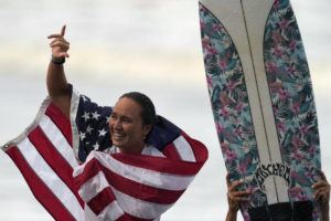 ASSOCIATED PRESS                                 Hawaii's Carissa Moore celebrates winning the gold medal in the women's surfing competition at the 2020 Summer Olympics, Tuesday, at Tsurigasaki beach in Ichinomiya, Japan.
