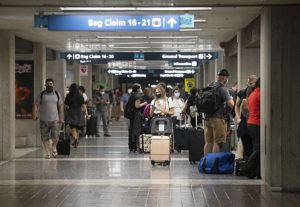 CINDY ELLEN RUSSELL / CRUSSELL@STARADVERTISER.COM                                 Travelers gather in the Terminal 2 baggage claim area of Daniel K. Inouye International Airport on Friday. Hawaii has seen a strong rebound in tourism over the past month.