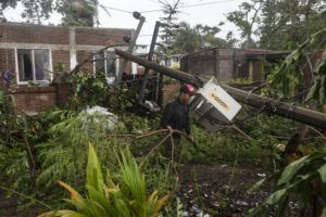 ASSOCIATED PRESS                                 A man inspects the damage after part of his home was toppled by winds brought on by Hurricane Grace, in Tecolutla, Veracruz State, Mexico. Grace hit Mexico's Gulf shore as a major Category 3 storm before weakening on Saturday, drenching coastal and inland areas in its second landfall in the country in two days.