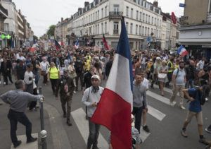 ASSOCIATED PRESS                                 Demonstrators march in Lille, northern France during a rally against the COVID-19 health pass needed to access restaurants, long-distance trains and other venues.