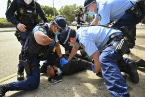 STEVEN SAPHORE/AAP IMAGE VIA AP                                 Police arrest a man during an anti-lockdown protest in Sydney, Australia. Protesters are rallying against government restrictions placed in an effort to reduce the COVID-19 outbreak.