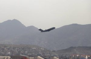 ASSOCIATED PRESS                                 A U.S military aircraft takes off from the Hamid Karzai International Airport in Kabul, Afghanistan, today.