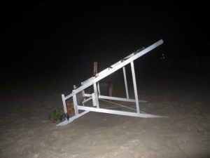 ASSOCIATED PRESS                                 A lifeguard chair sits overturned on the sand at the beach in Berkeley Township, N.J., where a young lifeguard was killed and seven others injured by a lightning strike today.