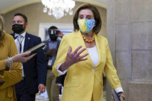 ASSOCIATED PRESS                                 Speaker of the House Nancy Pelosi, D-Calif., leaves the chamber after urging advancement of the John Lewis Voting Rights Advancement Act, named for the late Georgia congressman who made the issue a defining one of his career, at the Capitol in Washington.