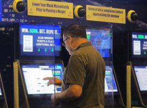 ASSOCIATED PRESS                                 A gambler places a bet at the FanDuel sportsbook in East Rutherford N.J.