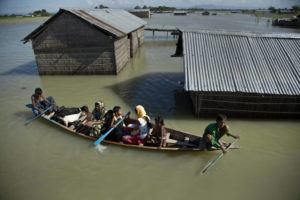 ASSOCIATED PRESS / JULY 31, 2016                                 A flood-affected family with their goats travel on a boat in the Morigaon district, east of Gauhati, northeastern Assam state, India, in 2016. Climate change could push more than 200 million people to move within their own countries in the next three decades and create migration hotspots unless urgent action is taken in the coming years to reduce global emissions and bridge the development gap, a World Bank report has found.