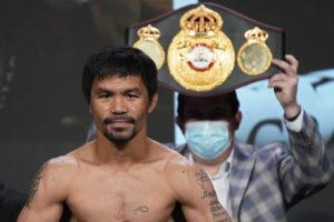 ASSOCIATED PRESS                                 Manny Pacquiao poses for photographers during a weigh-in in Las Vegas on Aug. 20. P