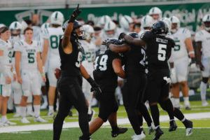 JAMM AQUINO / JAQUINO@STARADVERTISER.COM                                 Hawaii players celebrated after senior Pita Tonga (49) intercepted a pass in the first quarter against Portland State at Clarence T.C. Ching Complex on the UH campus.