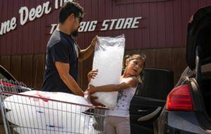 TAILYR IRVINE/THE NEW YORK TIMES                                 Troy Haugen and his daughter, Ahmara, loaded ice into their car as temperatures reached 106 degrees in Lame Deer on the Northern Cheyenne Reservation in Montana, on July 18. The period from June through August this year was the hottest on record in the United States, exceeding even the Dust Bowl summer of 1936, the National Oceanic and Atmospheric Administration said today.
