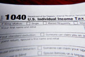ASSOCIATED PRESS                                 A 1040 federal tax form printed from the Internal Revenue Service website.