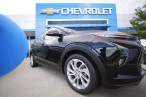 ASSOCIATED PRESS / AUG. 29                                 A lone, unsold 2022 Bolt electric vehicle sits outside a Chevrolet dealership in Englewood, Colo.