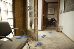JAY JANNER/AUSTIN AMERICAN-STATESMAN VIA AP / SEPT. 29                                 A rock remains on the floor at the Travis County Democratic Party office on East 6th Street in Austin, Texas, after someone threw a rock and an incendiary device into the building.
