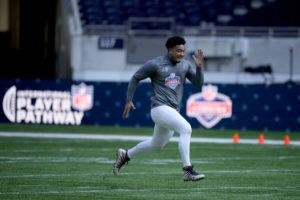 ASSOCIATED PRESS                                 New Zealand's defensive lineman Shawn Tuione, a former member of the Te Papapa-Onehunga rugby club, takes part in the NFL International Combine at the Tottenham Hotspur Stadium in London.