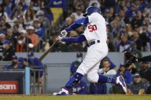 The Los Angeles Dodgers' Mookie Betts hits a two-run home run during the fourth inning against the San Francisco Giants.