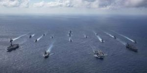 U.S. NAVY VIA AP                                 In this photo released by the U.S. Indo-Pacific Command, the United Kingdom's carrier strike group led, by HMS Queen Elizabeth, and Japan Maritime Self-Defense Forces, led by Hyuga-class helicopter destroyer JS Ise, joined with U.S. Navy carrier strike groups led by flagships USS Ronald Reagan and USS Carl Vinson to conduct multiple carrier strike group operations in the Philippine Sea on Oct. 3.