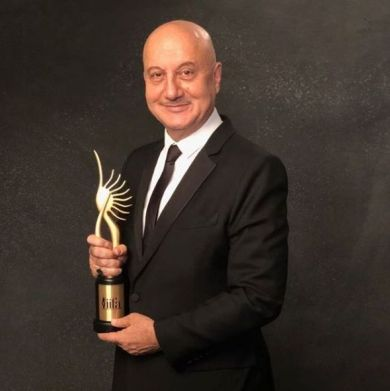 Anupam Kher with the Outstanding Achievement Award
