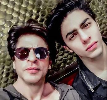 Aryan Khan with his father