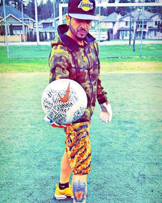 Jazzy B loves playing football
